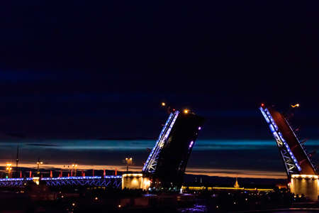 Opening of Palace drawbridge. Night view of Palace bridge from the Neva river in Saint Petersburg, Russia