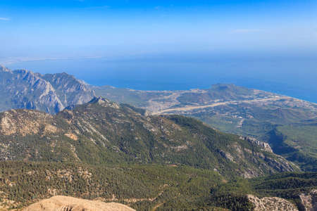 View of the Taurus mountains and the Mediterranean sea from a top of Tahtali mountain near Kemer, Antalya Province in Turkey Banco de Imagens