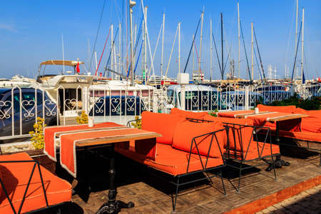 Cozy cafe in a sea harbor of Kemer (Kemer Marina) on the Mediterranean sea in Turkey