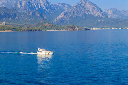 White luxury yacht sailing in the Mediterranean sea in Kemer, Antalya province, Turkey. Turkish riviera