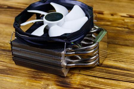 Modern CPU cooler on a wooden desk