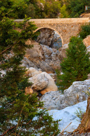Ancient stone bridge across a mountain river in Kesme Bogaz canyon, Antalya province in Turkey