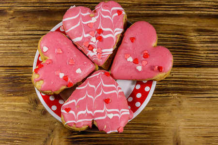 Heart shaped cookies on wooden table. Top view. Dessert for valentine day