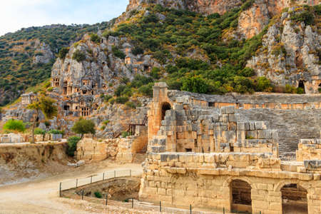 Ruins of ancient Greek-Roman theater and rock-cut tombs of Lycian necropolis of the ancient city of Myra in Demre, Antalya province in Turkey 写真素材