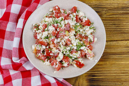 Tasty salad of tomato, cottage cheese, dill and olive oil on wooden table. Top view Stok Fotoğraf