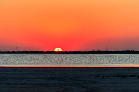 Beautiful orange sunset over a salt lake