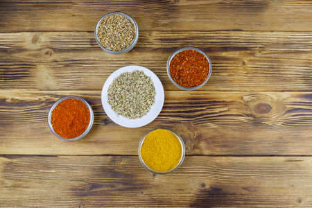 Set of different aromatic spices on wooden table. Top view Archivio Fotografico
