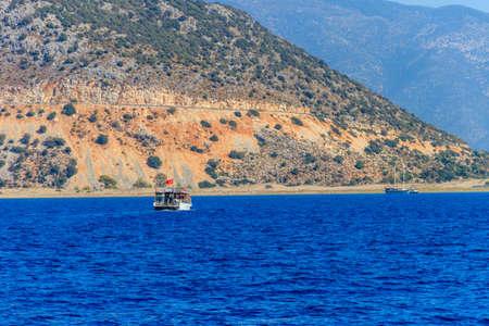 Tourist ship sailing in the Mediterranean sea near Kekova island in Antalya province, Turkey. Turkish riviera Archivio Fotografico