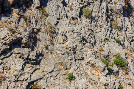 Natural texture of a mountain cliff rock for background