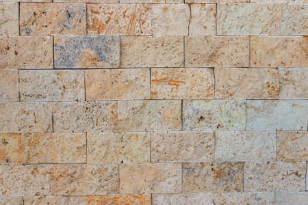Background of the beige travertine tiles