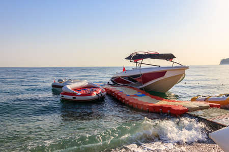 Speedboat and water tubes waiting tourists on a beach of the Mediterranean sea in Turkey
