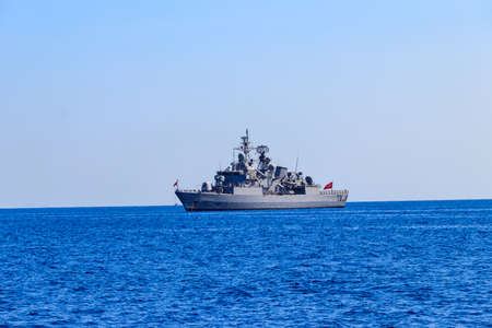Turkish navy warship sailing in the Mediterranean sea. Protection of water borders of Turkey Stock Photo