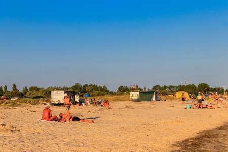 Lazurne, Ukraine - July 19, 2020: Tent camp on a beach of the Black sea in Lazurne, Ukraine