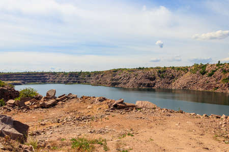 View of the lake at abandoned quarry on summer