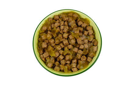 Canned food for cats or dogs in ceramic green bowl isolated on white background. Top view 免版税图像