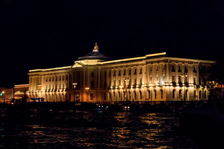 Building of Academy of Arts on a bank of the Neva river in Saint Petersburg, Russia. Night view