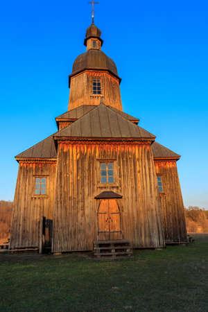 Wooden 18th century church of St. Nicholas in authentic Cossack farm in Stetsivka village in Сherkasy region, Ukraine