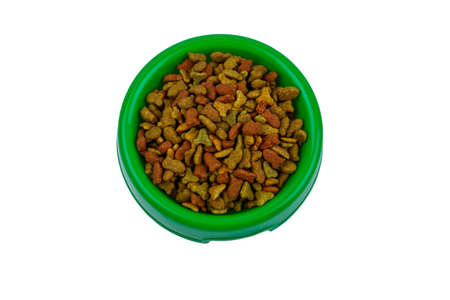 Dry food for cat or dog in a bowl. Pet food isolated on white background Banco de Imagens