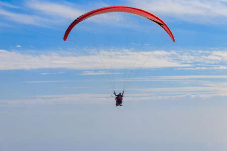 Paragliders in blue sky. Concept of active lifestyle and extreme sport adventure