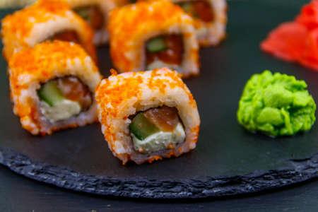 Sushi rolls Philadelphia on a black slate 免版税图像