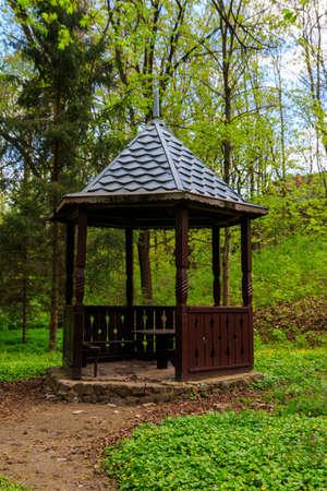 Small wooden gazebo in the Krasnokutsk park, Kharkiv region, Ukraine Banco de Imagens