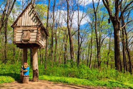 Wooden fairytale house of Baba Yaga in the Krasnokutsk park, Kharkiv region, Ukraine Banco de Imagens