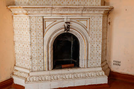 Vintage fireplace in a living room of abandoned palace Banco de Imagens