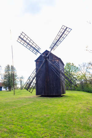 Old wooden windmill in Open-air Museum of Folk Architecture and Folkways of Middle Naddnipryanschina in Pereyaslav, Ukraine