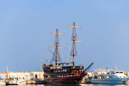 Stylized pirate yacht in marina harbor in Kemer, Turkey