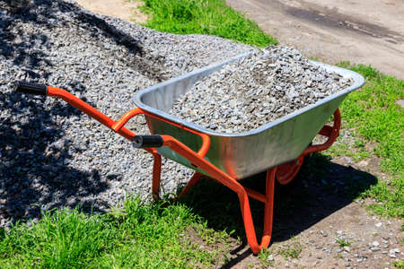 Wheelbarrow with gravel at the construction site