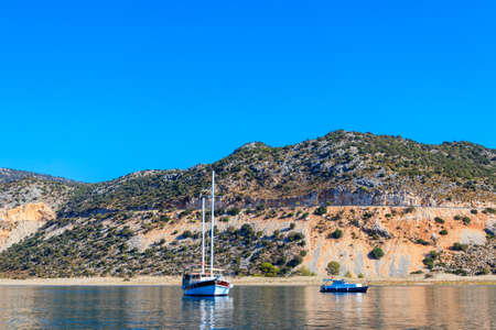Yachts sailing in the Mediterranean sea near Kekova island in Antalya province, Turkey. Turkish riviera 免版税图像