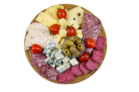 Antipasti platter with olives, cherry tomatoes, assortment of italian salami and cheese isolated on white background 免版税图像