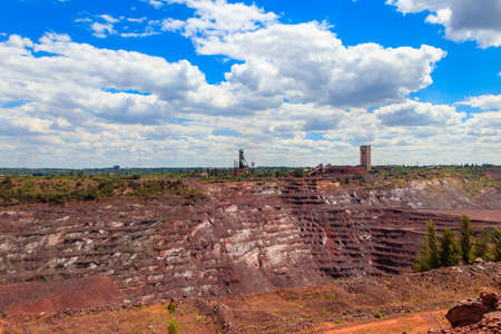 View of huge iron ore quarry in Kryvyi Rih, Ukraine. Open pit mining