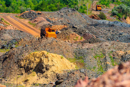 Heavy truck working in the iron ore quarry 免版税图像