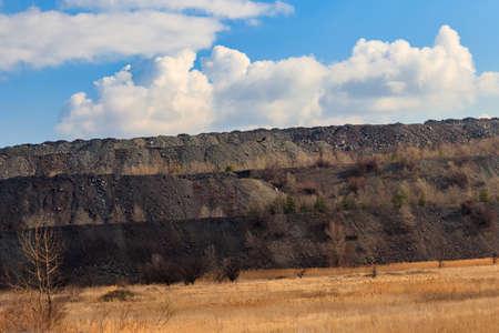 View of slag heaps of iron ore quarry. Mining industry 免版税图像