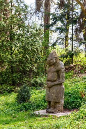 Ancient stone statue of the scythian warrior in the Krasnokutsk park, Kharkiv region, Ukraine