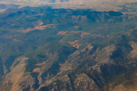 View of the Taurus mountains in Antalya province, Turkey. View from airplane 免版税图像