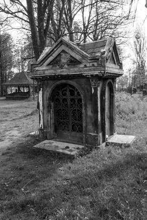 Old stone crypt on the ancient cemetery. Black and white tone