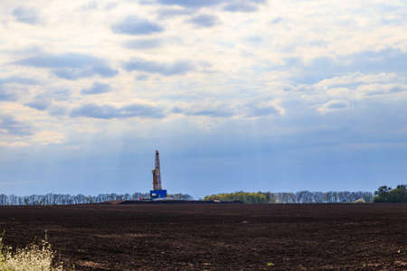 Land oil drilling rig on the field