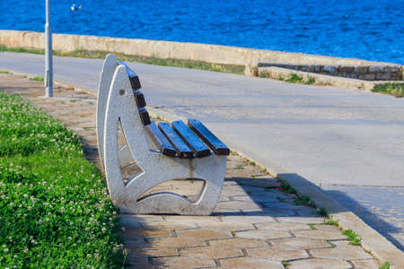 Bench on the embankment of the sea
