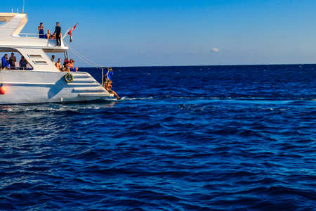 Hurghada, Egypt - December 7, 2018: White yacht sailing in Red sea, Egypt
