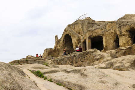 Uplistsikhe, Shida Kartli region, Georgia - May 6, 2018: Old cave city Uplistsikhe in Caucasus mountains, Georgia Редакционное