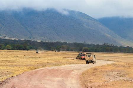 Off road cars driving in Ngorongoro crater. African safari in Ngorongoro Crater National park in Tanzania Фото со стока
