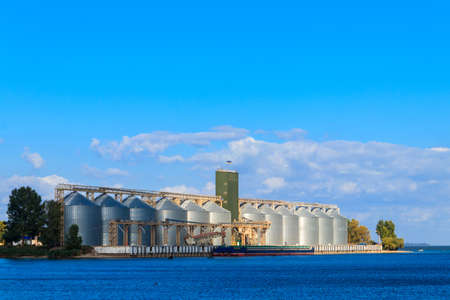 Modern granaries for storing cereal grains on a bank of the Dnieper river
