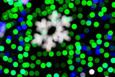 Festive multicolored blurred abstract background. Christmas lights bokeh background Фото со стока