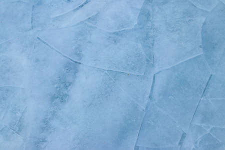 Texture of the cracked ice. Winter background