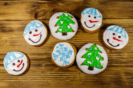 Christmas gingerbread cookies on a wooden background. Top view