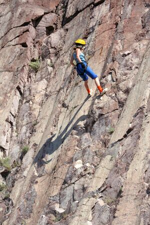 woman climbing on the rock Stock Photo - 2085836