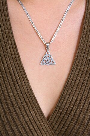 Background. Close up celtic jewelry on body Standard-Bild