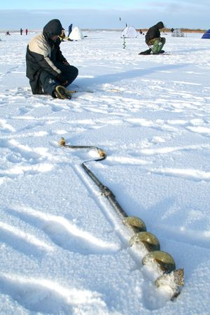 Fishing drill on an ice of the frozen lake Stock Photo - 2496770